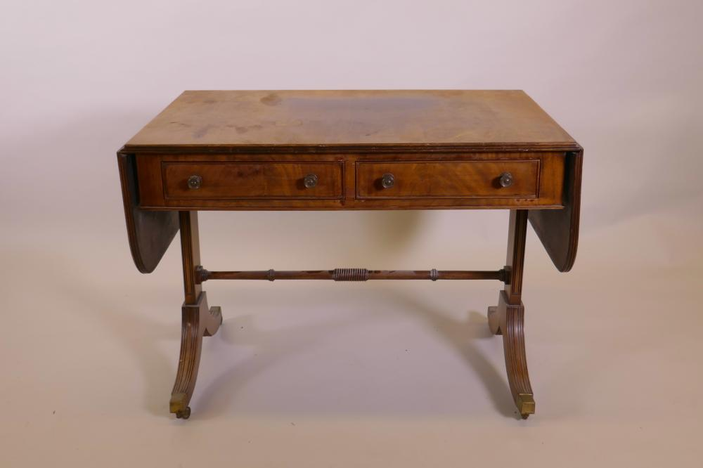 A Regency Style Mahogany Sofa Table With Two Frieze Drawers On