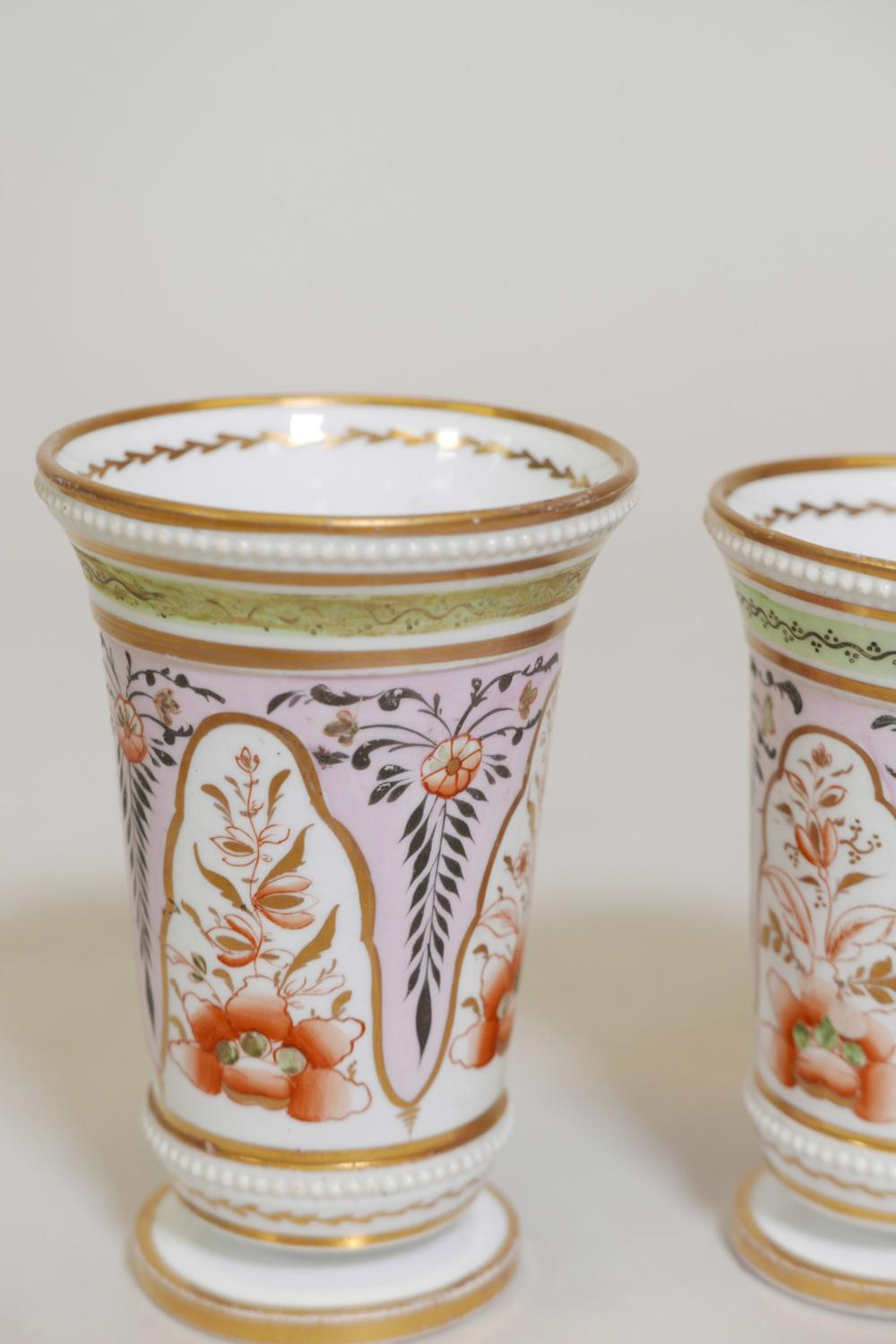 Two hard paste porcelain vases with hand painted decoration and
