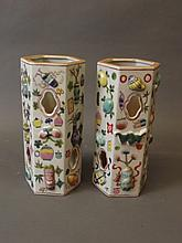 A pair of Chinese hexagonal reticulated porcelain vases with relief polychrome decoration of vases and precious items, seal mark to base, 10½'' high