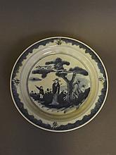 A Chinese blue and white dish decorated with a sage and a young boy in a garden, 8¼'' diameter