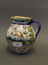 A Continental Majolica jug painted with deer, 6½'' high