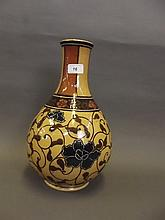 A good large C19th Wedgwood pottery vase painted with Persian style stylised flowers, impressed mark, 13½'' high