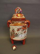 A large C19th Japanese Kutani twin handled jar and cover surmounted by a figure, 13½'' high (AF knop)