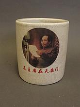 A Chinese crackleware brushpot with applied decoration of Chairman Mao, inscription verso, 6 character mark, 4¾'' x 4¼''