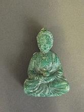 A Chinese green hardstone pendant carved in the form of Quan Yin, 2½'' high