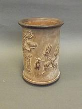 A Chinese bamboo brush pot with carved flowering