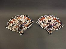 A pair of fan shaped porcelain dishes decorated in