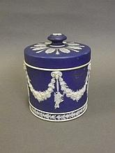 A Wedgwood Jasperware circular biscuit barrel