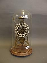 A C19th brass skeleton clock striking on a bell, brass plaque to base, inscribed 'Dent 8 Days, London, Warranted', on a wood base, 16½'' high