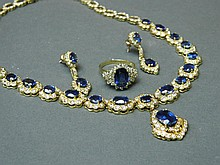 An 18ct gold diamond and sapphire set necklace with matching ring and earrings, 17'' long