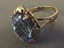 A 9ct gold blue topaz and diamond ring, size Q