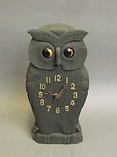 A carved and painted wooden automaton clock in the form of an owl, 9¾'' high