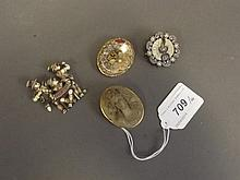 A gold mounted carved cameo brooch, a micro Mosaic brooch, and two others