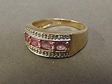 A 9ct gold pink sapphire and diamond band ring, size O