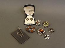 Nine items of Scottish Celtic jewellery to include earrings and brooches, 3'' long