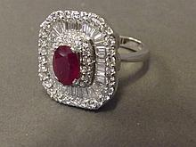 An 18ct white gold, ruby and baguette 4ct diamond