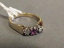 A lady's 9ct gold diamond and ruby ring in crown
