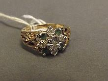 A lady's 9ct gold emerald and diamond set ring,