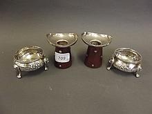 A pair of ornate silver plated salts, and a pair