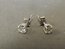 A pair of 18ct white gold diamond ear studs
