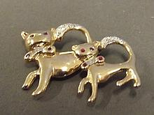 A 9ct gold brooch in the form of a cat with inset