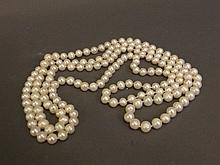 A long string of fresh water pearls, 52