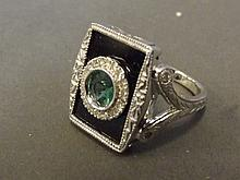 A 14ct white gold square set emerald, diamond and