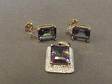 A 9ct gold Mystic topaz and diamond earring and
