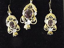 A 9ct gold diamond and amethyst pendant and