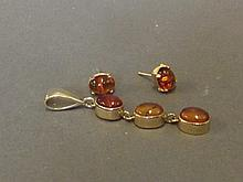 A 9ct gold earring and pendant set with Baltic