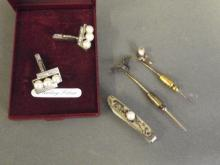 Two corsage pins, one decorated with a bat, Sterling silver pearl set tie pin etc