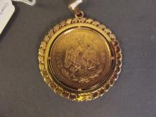 A 24ct gold Mexican 50 peso coin in a gold mount, 55g