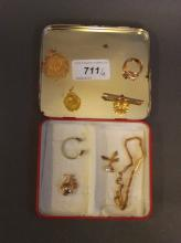 An 18ct gold pierced pendant, an 18ct gold bar brooch, an antiques gold snake ring (AF), gold bracelet etc