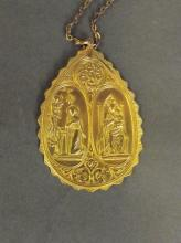 A high carat gold pendant on chain depicting the Annunciation, 17g