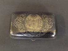 An Eastern silver and niello rectangular box decorated with a coat of arms, 4'' wide, 116g