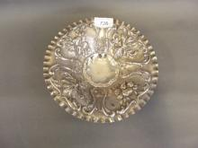 A Continental cast silver bowl decorated in relief with fruits, 8'' diameter, 277g