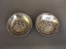 A pair of Continental silver dishes decorated with cherubs, 3¼'' diameter, 84g