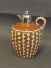A silver topped ceramic Whisky jug with basket design, Birmingham 1917, 7'' high