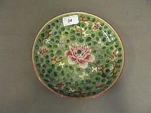 A 19th Century Chinese green ground pottery dish