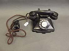 A vintage 200 Series Bakelite telephone with slide