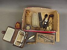 A box of vintage razors, pipes, gold scales,