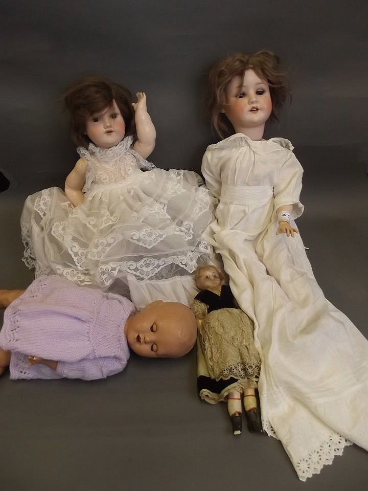 An Armand Marseille bisque headed doll, a Simon &