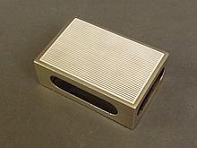A silver matchbox holder with enamelled front,