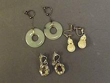 A pair of silver and jade pi-shaped earrings, a