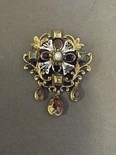 An early 19th Century pinchbeck pendant brooch set