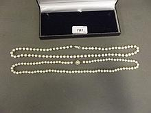 A string of cultured pearls with a silver clasp,