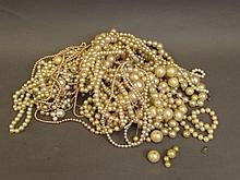 A large quantity of pearl beaded necklaces