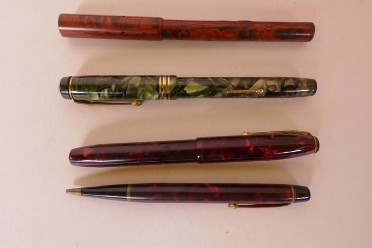 TWO CONWAY STEWART MARBLED CASED FOUNTAIN PENS WITH 14CT GOLD NIBS, A SIMILAR CONWAY STEWART PROPELLING PENCIL AND A MARBLED CASED FOUNTAIN PEN WITH 14CT GOLD NIB, A/F