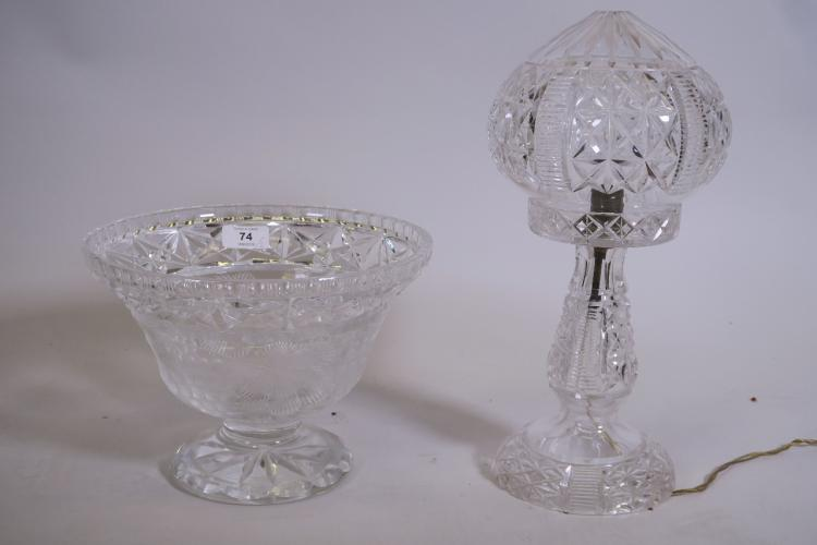 A CUT GLASS TABLE LAMP AND SHADE, AND A FRUIT BOWL WITH GRAPE AND VINE DECORATION