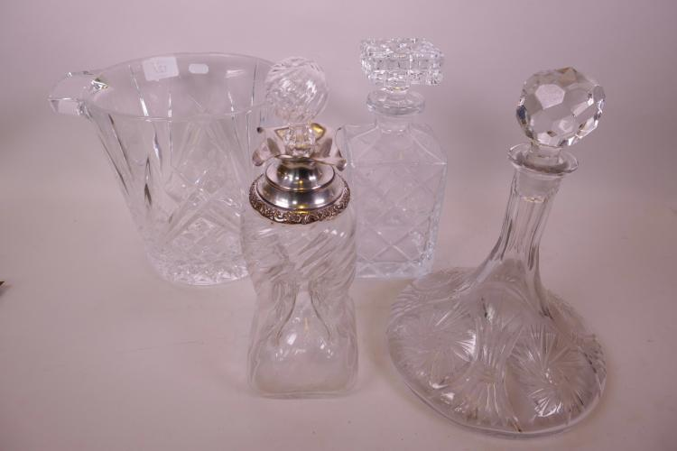 A WHORL PATTERN DIMPLE GLASS DECANTER WITH SILVER PLATED COLLAR TOGETHER WITH A LEAD CRYSTAL SHIP'S DECANTER, A SQUARE CUT CRYSTAL SPIRIT DECANTER AND A LARGE CRYSTAL ICE BUCKET, 8